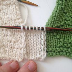How to seam two finished pieces of knitting with a knitted section, this technique can be particularly useful if you are making a blanket with many squares, or have made a garment that needs a little extra room. This seaming is easily removed as all you have to do is rip it out the same way you would with any knit fabric, and could be used for a design purpose such as adding a stripe of alternating color or a decorative element like a cable. To begin gather your two pieces that need…