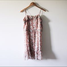 F21 | floral sundress Only Worn Once // excellent condition  ➵ pale pink, peach floral dress ➵ hits right at the knee  ➵ straps are adjustable  ➵ lightweight and flowy  Closet policies: 🚫 No trades 🚫 No PayPal 📦 Bundles =5% Discount Forever 21 Dresses Midi