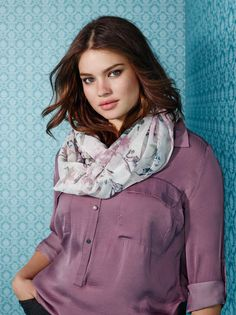 Plus size model Tara Lynn wearing the tunic blouse with printed scarf. Available at Addition Elle.
