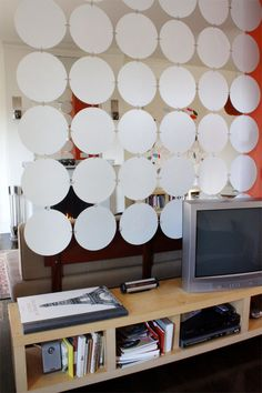 Old Records covered with contact paper and made into a room divider...could use old cds