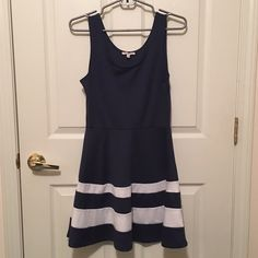 Navy & White Dress Navy and white fit and flare dress. Fitted top half with an A-line bottom skirt. Large white stripes across the bottom. Good condition. I'm 5'3 and this falls on me about mid-thigh. Charlotte Russe Dresses Mini