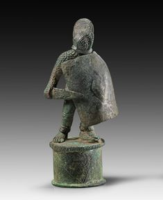 Roman bronze figure of a gladiator (secutor) with shield and sword on cylindrical base. 3rd century A.D.