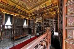Biblioteca Joanina, part of The University of Coimbra General Library, Coimbra, Portugal. This Baroque library was built in the century during the reign of King João V (and named after him). It contains about 250 thousand volumes. Beautiful Library, Dream Library, Library Books, All Over The World, Around The Worlds, Classic Library, College Library, Library University, Home Libraries