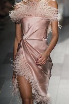 Elegant pink satin dress with ostrich feather trim