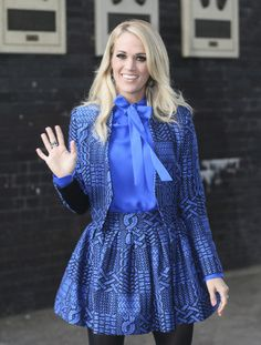 Carrie Underwood waves while leaving the ITV studios.