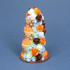 Dollhouse miniature wedding cake by Blue Kitty Miniatures, via Flickr