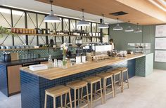 Operating a full-fledged café might not be on the annual plan for most real estate agencies, but when Property Brokers was casting the vision for their new Palmerston North hub, community was at the heart of the vision. Aesthetic Coffee, Real Estate Agency, It Cast, Table, Hospitality, Community, Heart, Home Decor, Projects