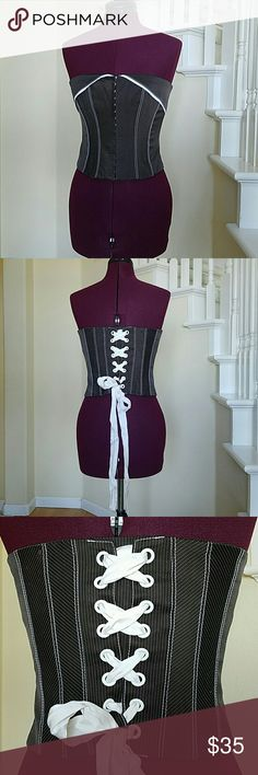 Bebe corset style top Chocolate brown with white pin stripes and eyelet front closure. It has a satin tie in the back and boning in the front to keep the shape Bebe Tops