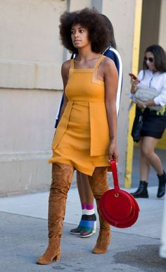 Must See New York Fashion Week Street Style, Fall 2015 - Solange Knowles in '70s hues, wearing brown suede over-the-knee boots, an orange mini dress, styled with a modern round red leather bag