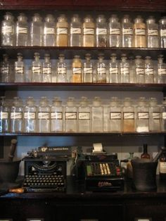 apothecary bottles and old cash register