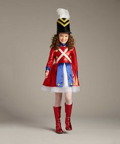 March your way into everyone's heart as this Rockettes toy soldier. The red, white and blue dress has a fluffy skirt. A Wishcraft costume by Chasing Fireflies.