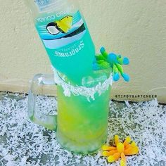 OCEAN FLOOR: 1/2 oz. (15ml) Coconut rum, 1 oz. (30ml) Pineapple juice, 1 oz. (30ml) Orange juice, &  Seagram's Calypso Colada.