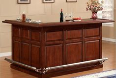 The+L-shape+home+bar+cabinet+creates+extensive+storage+with+some+open+shelving+and+some+closed+storage.+