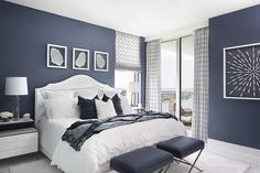 Sherwin Williams Indigo Batik The master bedroom is saturated in a rich dusty navy blue with a white bed and night tables that pop against the wall color Blue Bedroom Paint, Blue Master Bedroom, Best Bedroom Colors, Blue Bedroom Decor, Bedroom Color Schemes, Navy Bedroom Walls, Indigo Bedroom, Master Bedrooms, Navy White Bedrooms