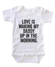 """- These """"Love is Waking My Daddy Up in the Morning"""" Onesies will sure to make all daddys very happy. Perfect for baby shower and father day gift. - Color: White/Black/Pink/Blue - Material: 100% Cotton"""