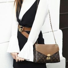 Black and white outfit with Louis Vuitton handbag.