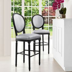 Give your kitchen a modern look with this sleek black and silver counter stool. This Philip stool has eco-leather coverings featuring a croc pattern to give your kitchen added flair. These unique stools have a sturdy oak frame and a foot bar.