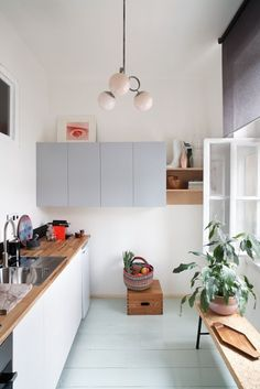 simple kitchen, painted floorboards