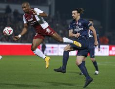 Metz's Florent Malouda (L) challenges Paris St Germain's Zlatan Ibrahimovic during their French Ligue 1 soccer match at the Saint Symphorien stadium in Metz November 21, 2014. REUTERS/Vincent Kessler