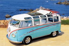 "Volkswagen T2 Microbus Deluxe model 244 | first built in 1951 | splitting the windshield and roofline into a ""vee"" helped the production Type 2 achieve a drag coefficient of 0.44. The Transporter first generation T2 pre 1967 [mistakenly called T1]"