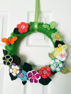 Crochet spring wreath. Button flowers.