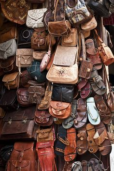 Leather bags & slippers at the souk in the Fez Medina, Morocco
