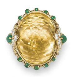 A CITRINE, DIAMOND AND EMERALD RING, BY VAN CLEEF & ARPELS   Of bombé design, set with a faceted oval-shaped citrine, within a cabochon emerald surround and circular-cut diamond and cabochon emerald shoulders, mounted in gold  Signed V.C.A. for Van Cleef & Arpels, no. 44149