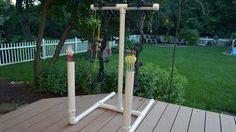 Directions, material list, tools list and dimensions for building your own PVC bow stand with built-in arrow holders.