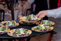 Mixed greens salad with pomegranate seeds, goat cheese and assorted fruits | Studio 616 Photography | villasiena.cc