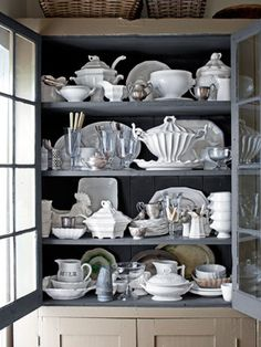 A built-in kitchen cabinet stores a collection of English ironstone and Chicago-made Red Cliff pottery.