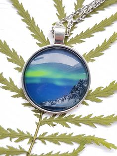 Necklace with my photography of the northern lights. Taken by me at Andøya, Norway. Size of picture is cm. Keep away from water Star Photography, Nature Photography, Holidays In Norway, Types Of Rings, Yellow Flowers, Handmade Necklaces, Northern Lights, Jewelry Making, Pictures