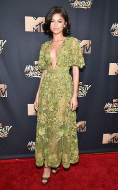 Zendaya from 2017 MTV Movie & TV Awards: Best Dressed Stars  The actress and singer was a modern-day '50s bombshell, in a see-through, olive-green dress with floral embellishments and a plunging neckline. The side-parted bob was the perfect hairstyle for this look!