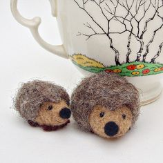 Needle felted hedgehogs. So stinkin' cute!