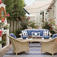 An outdoor living room with a fireplace extends your living area to ensure use year-round if you live in a temperate climate. Paint the brick to match the décor to create a polished look. Coastalliving.com