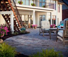 Splashes of color appear throughout this patio in both planted and potted flowers. Potted Flowers, May Flowers, Flower Pots, Stamped Concrete, Concrete Patio, Belgard Pavers, April Showers, Patio Ideas, Color Splash