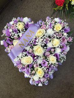 Lila and white loose heart, funeral arrangement. Made by Butterflies and Blooms www.butterfliesandblooms.net