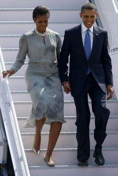 President Barack Obama, right, and first lady Michelle Obama, left, arrive at