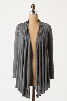 I have several variations of this sweater type and love them. Thin enough to not swelter, lose enough to cover the rear ;)