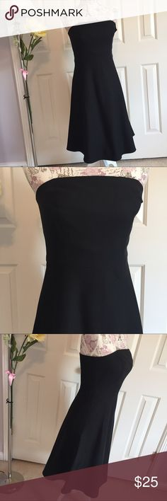 """Ann Taylor Strapless Black Dress Little black Strapless dress from Ann Taylor. 15"""" bust. 14"""" waist. 34"""" top to hem. Fully lined. Adjustable bodice. Concealed side zip. Cotton/ silk & 100% acetate. Hanging straps were cut off so they don't keep hanging out. Can be hang with clip hanger as shown. Very nice formal dress. Cleaned and in excellent worn condition. Ann Taylor Dresses Strapless"""