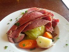 St. Patrick's Day food. Corned Beef with boiled cabbage, potatoes and carrots.  We just call this dinner.  Yummy.