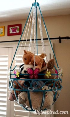 Garden hanging planter turned into stuffed animal storage for kid's room. saw lots of simple baskets at the dollar tree