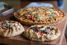 This gluten free tomato tart is shaped into galettes for ease and maximum flaky crust. Topped with olives and feta, the Mediterranean flavors shine bright.
