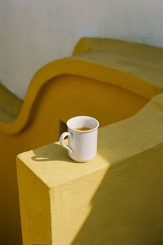 People Footwear - Inspiration - White Cup on a Yellow Ledge