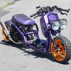 purple Honda Ruckus custom with orange rims