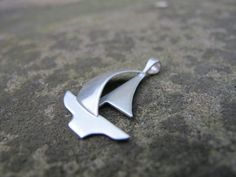 hand fabricated silver sailboat pendant made to by simplyMegA