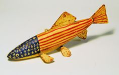 fish decoy carved of cedar with tin fins. weighted with lead. http://www.artshaman.blogspot.com/