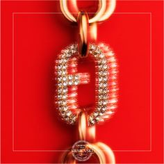 The new Furla is dressed in crystals to mark the occasion. This tough, contemporary chain-link bracelet features one link showcasing the Italian fashion house's updated logo in clear Swarovski crystals.