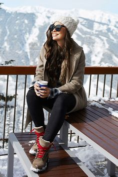 15 Chic And Cozy Snow Day Outfits: Fashion blogger: 'With Love From Kat' wearing a white beanie, a beige coat, a black sweater, black skinny jeans and brown lace-up snow boots. winter outfit, snow day outfit, polar vortex outfit, ski trip outfit, casual outfit, snow day style, winter style, winter fashion 2018, #winterstyle #ootd #snowdaystyle #polarvortex #winterfashion #bloggerstyle #streetstyle