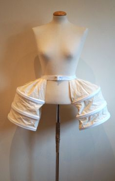This listing is for a custom made 18th Century cotton ruffled petticoat and pannier/pocket hoop set. These delicately simple 18th century