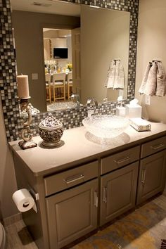 """Framed"" Mirror in Bathroom. Could diy!"